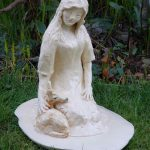 10-inch hand-built, stoneware sculpture of Gaia comforting a deer, by Peggy Grigor