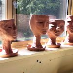 8-inch hand-built, brown stoneware planters, by Peggy Grigor